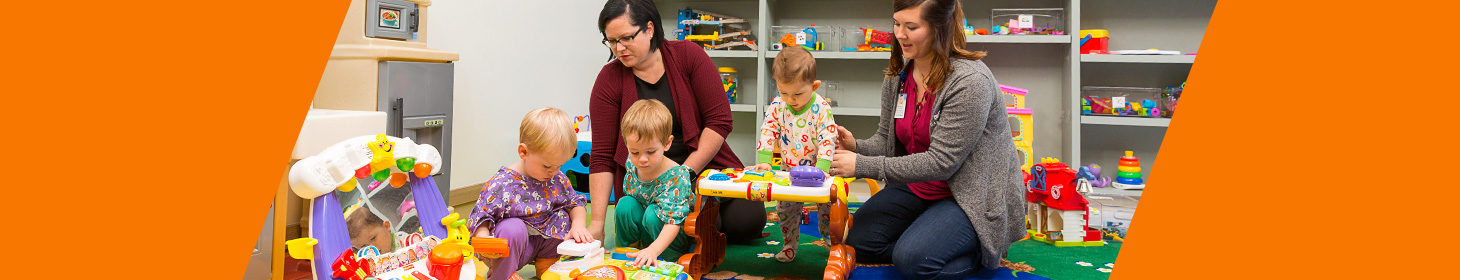 children and medical staff playing with toys in a medical playroom setting